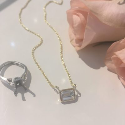The stone was so stunning that we wanted to keep it simple,using a thin bezel setting for the stone. The pendant looks like it's floating on the skin. We fell in love.